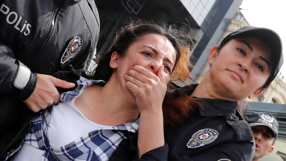 Police detain a protester after marching on Taksim Square to celebrate May Day in Istanbul, Turkey May 1, 2019