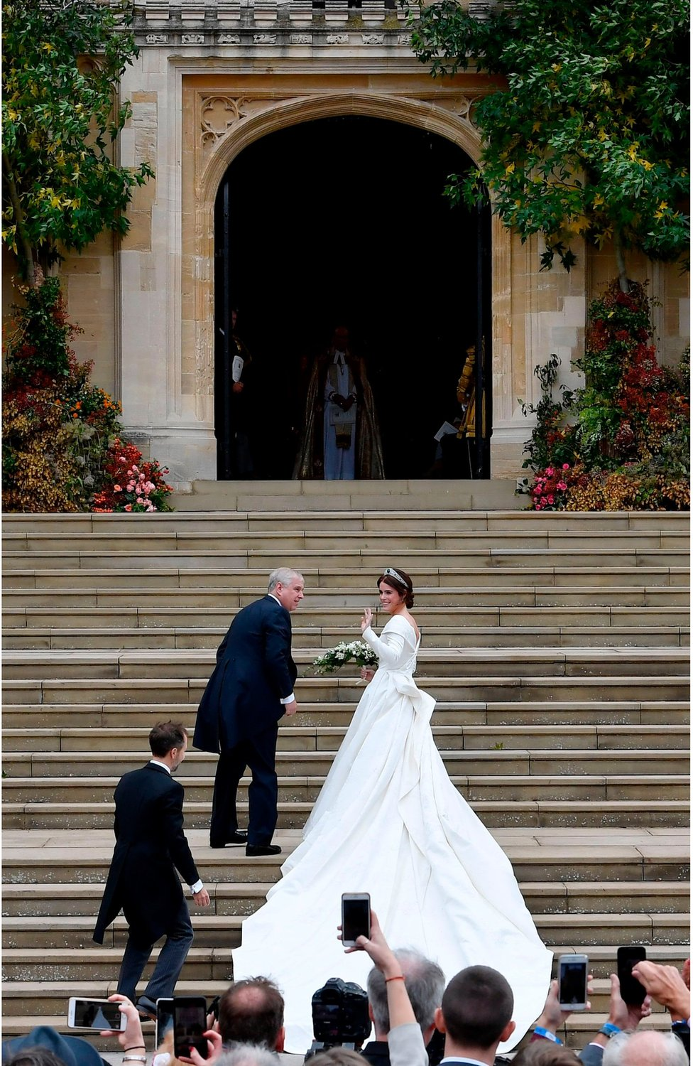 Princess Eugenie of York climbed the steps with her father Prince Andrew, Duke of York