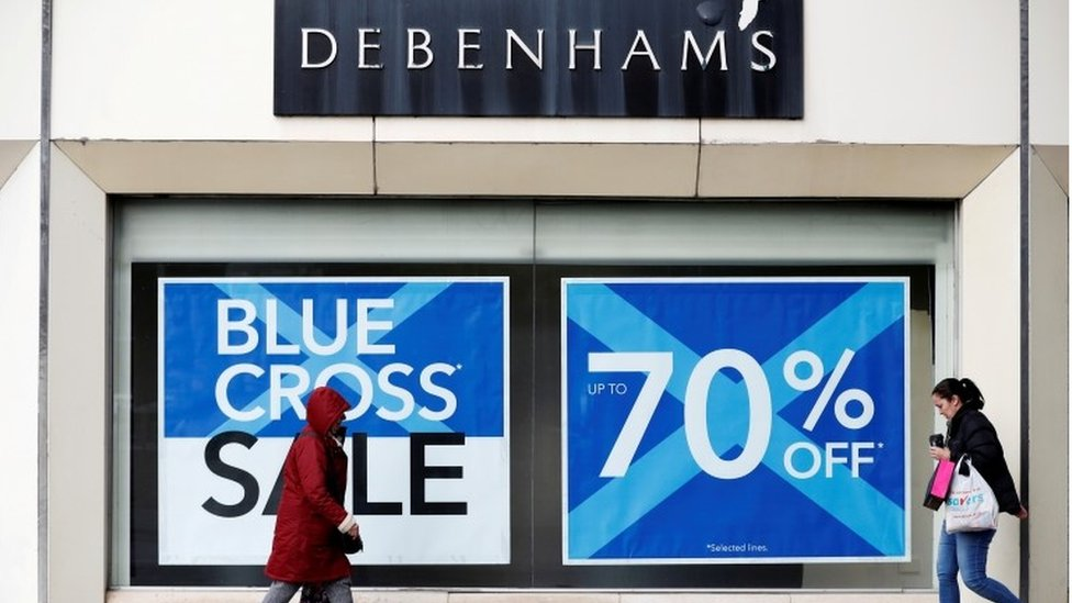 Exterior Debenhams store Stockport with Blue Cross signs