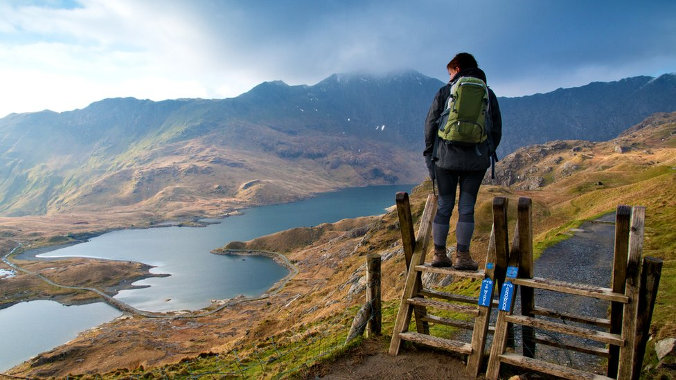 Pyg track path with woman on stile
