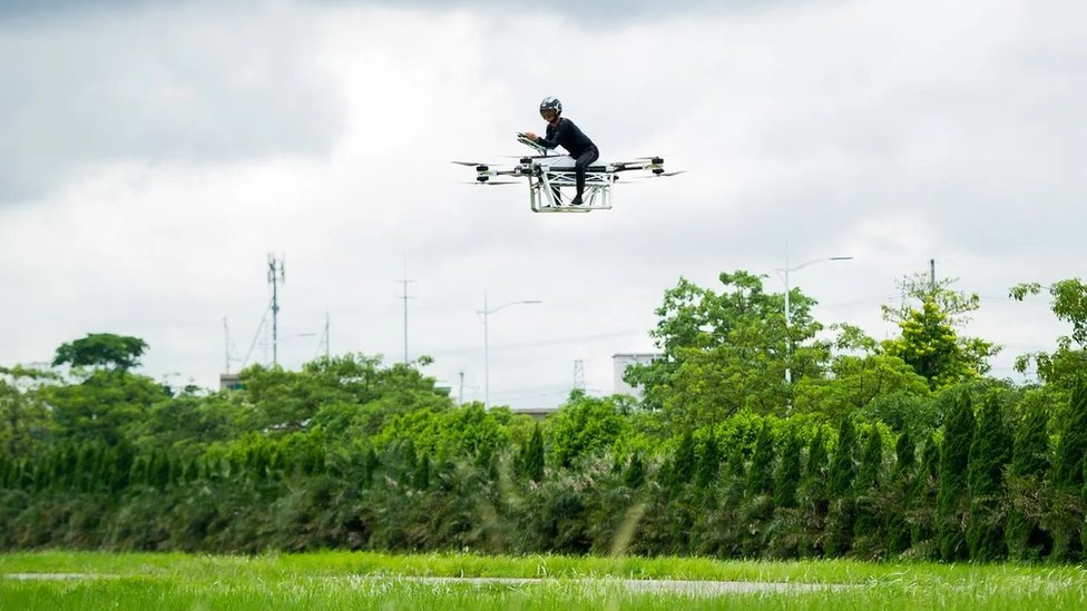 Zhao Deli rides a flying motorbike, which he built himself, during a test flight in 2019 in China