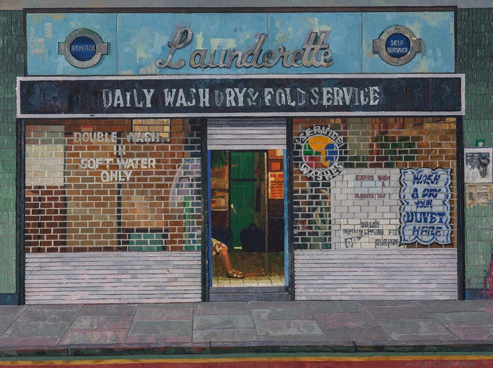 A painting of the front of a launderette with a woman sitting inside the doorway by Doreen Fletcher