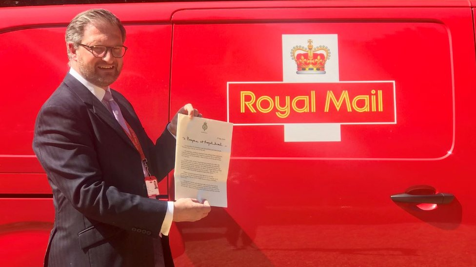 Royal Mail director of public affairs David Gold holds up the letter