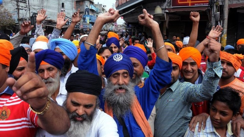 Sikh activists shout slogans during a protest over the alleged desecration of the Sikh holy book at a village near Tarn Taran, in Amritsar, India, 19 October 2015