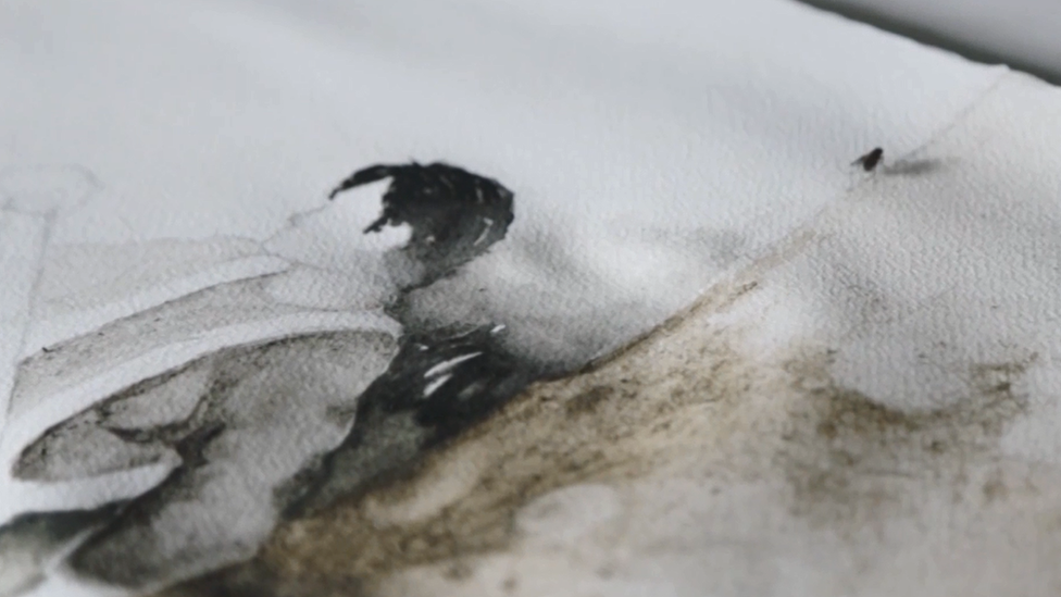 A fly sits on a painting produced by the Dirty Watercolour team