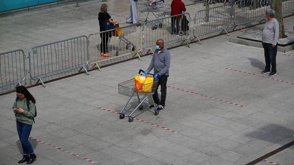 Queue to get into supermarket