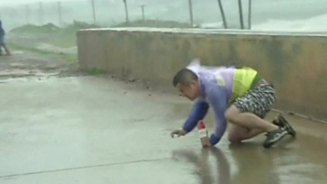 Man trying to get up in the strong wind