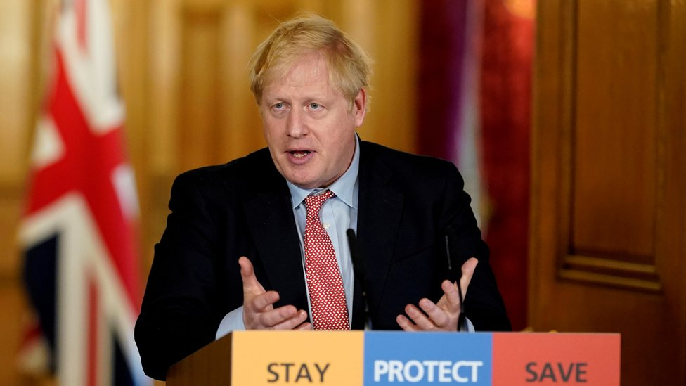 "Britain""s Prime Minister Boris Johnson speaks during his first remote news conference on the coronavirus disease (COVID-19) outbreak, in London, Britain March 25, 2020"