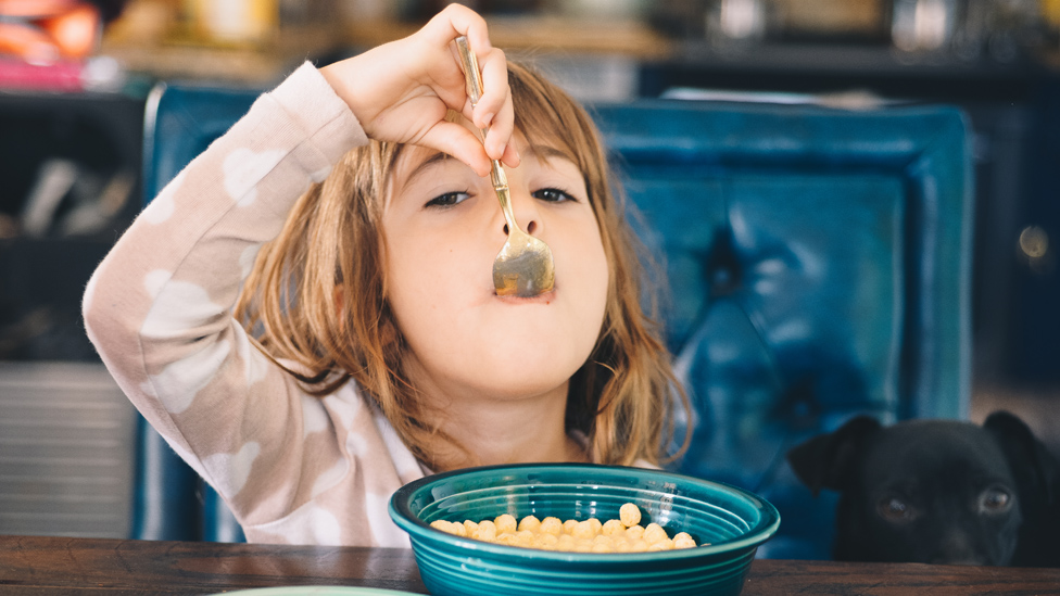A girl eating cereal