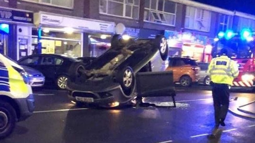 Woman and child treated as car overturns in Barry