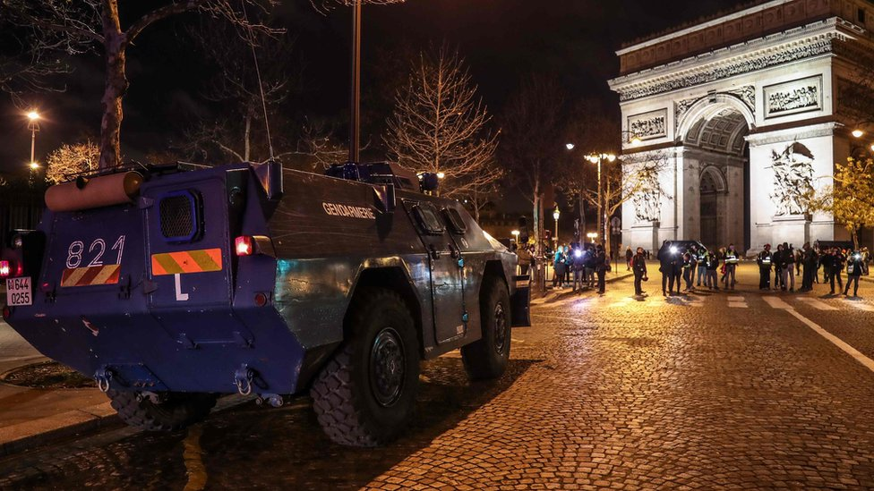 Armoured vehicle near the Arc de Triomphe in central Paris - 8 December