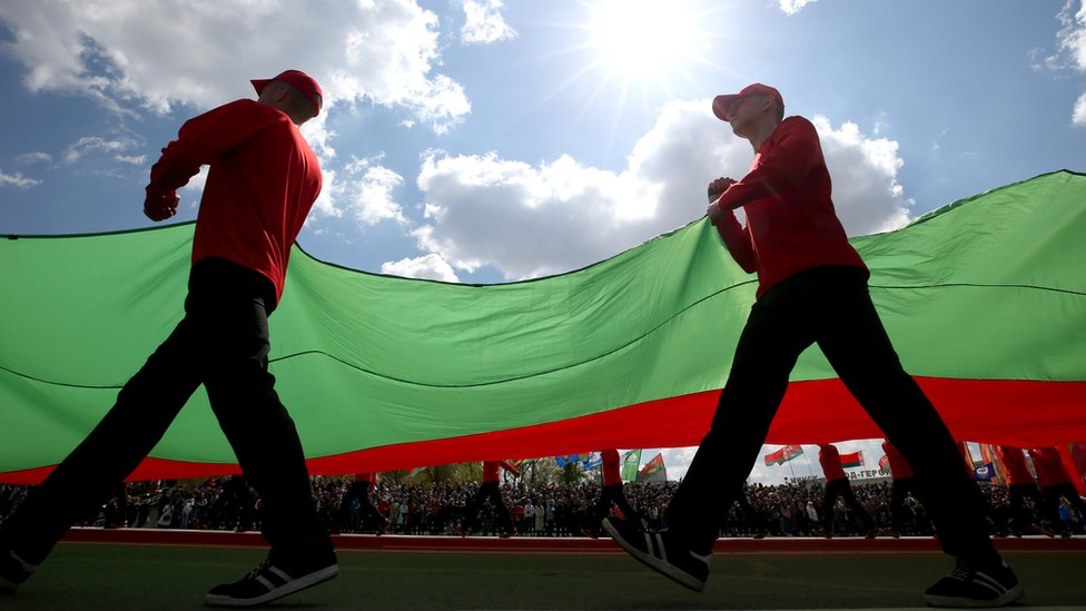 People carry a Belarus flag