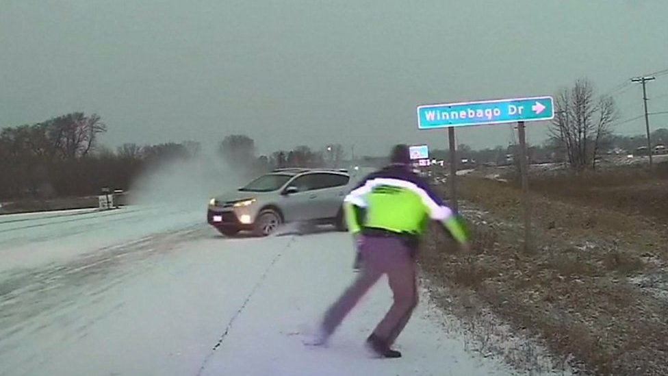 Wisconsin police officer narrowly avoids sliding car