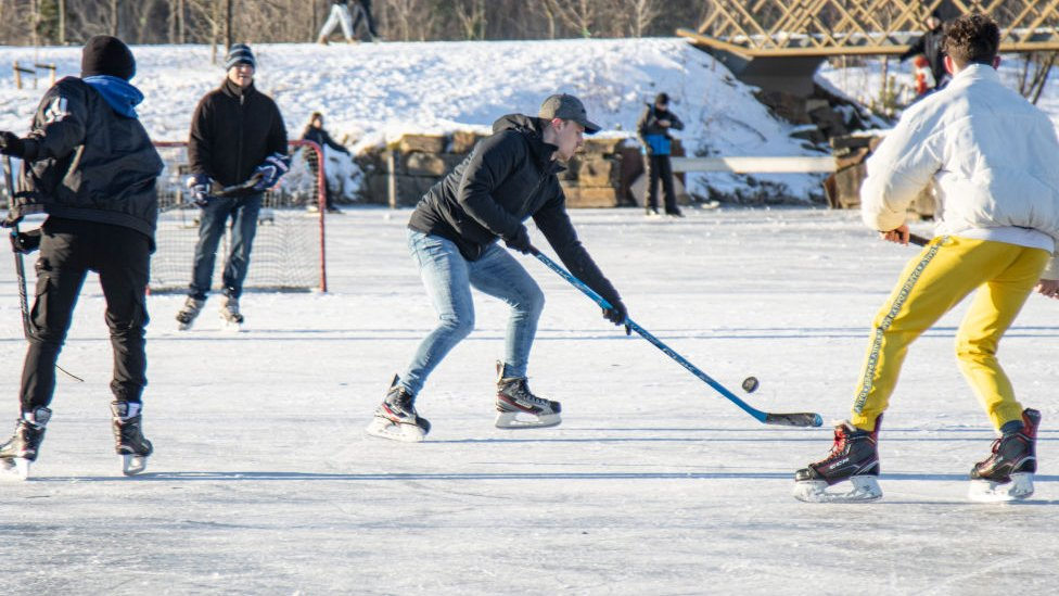 Skaters play hockey in Park Meerland close to the city of Eindhoven on 13 February 2021