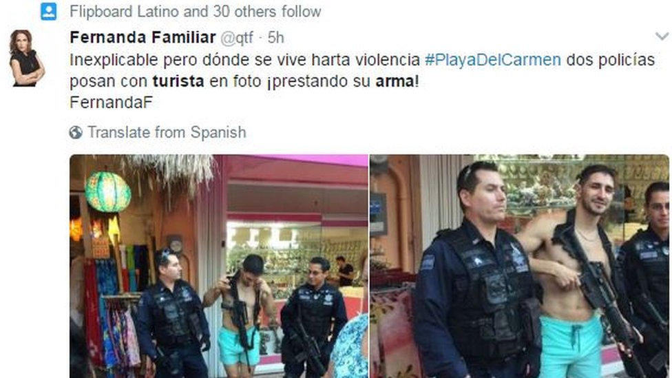 "Tweet by Fernanda Familiar reading: ""Inexplicable, where there is a lot of violence #PLayaDelCarmen two police officers pose for a photo with a tourist, lending him their weapon!"""