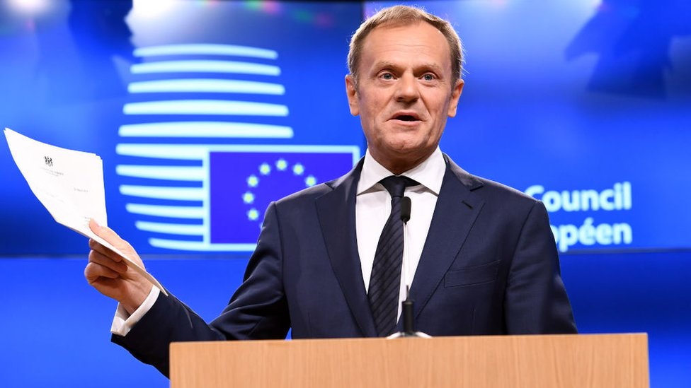 European Council President Donald Tusk holds British Prime Minister Theresa May's formal notice of the UK's intention to leave the bloc under Article 50 of the EU's Lisbon Treaty that was delivered to him by Britain's ambassador to the EU, during a press conference in Brussels on March 29, 201