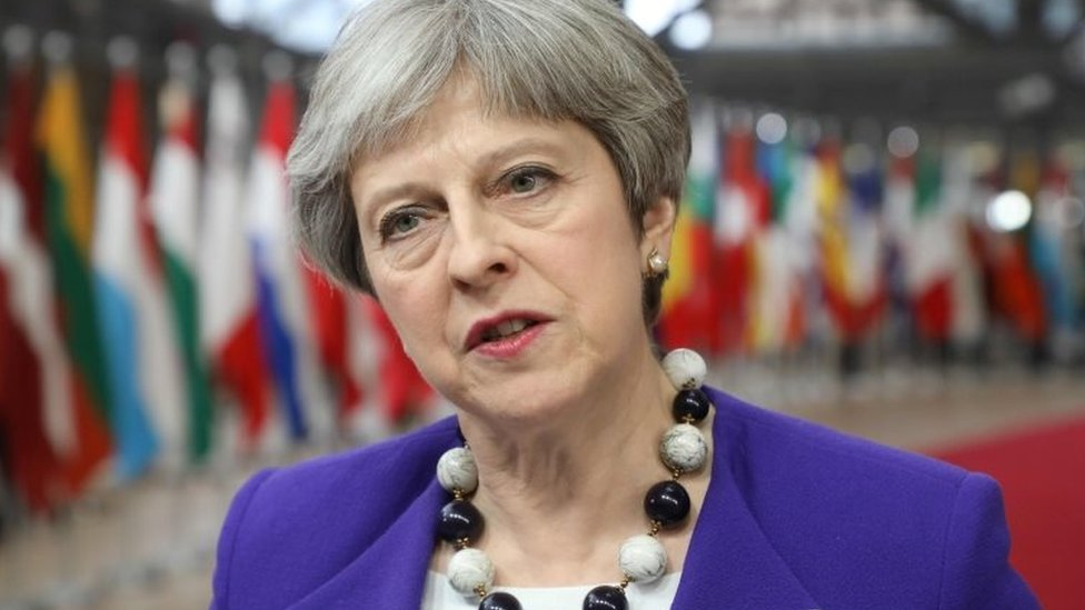 Theresa May being interviewed at EU headquarters in Brussels