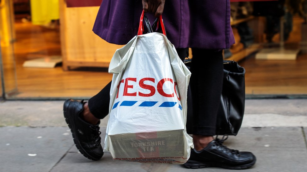 Shopper with a reusable plastic bag from Tesco