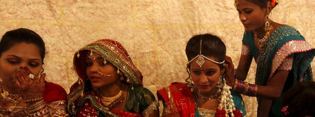 A Hindu bride and her party prepare as they wait for their wedding to start during a mass marriage ceremony in Karachi in Pakistan's Sindh province on 24 January 2016
