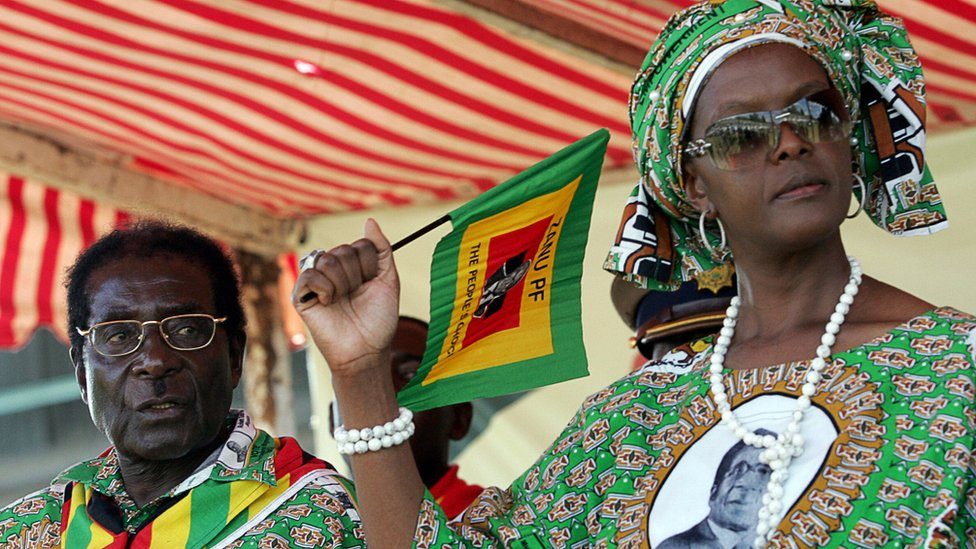 """Zimbabwe President Robert Mugabe and leader of the rulling party ZANU PF (Zimbabwe African National Union - Patriotic Front party) and his wife Grace attend at Mugabe""""s campaign rally in Harare on March 28, 2008."""