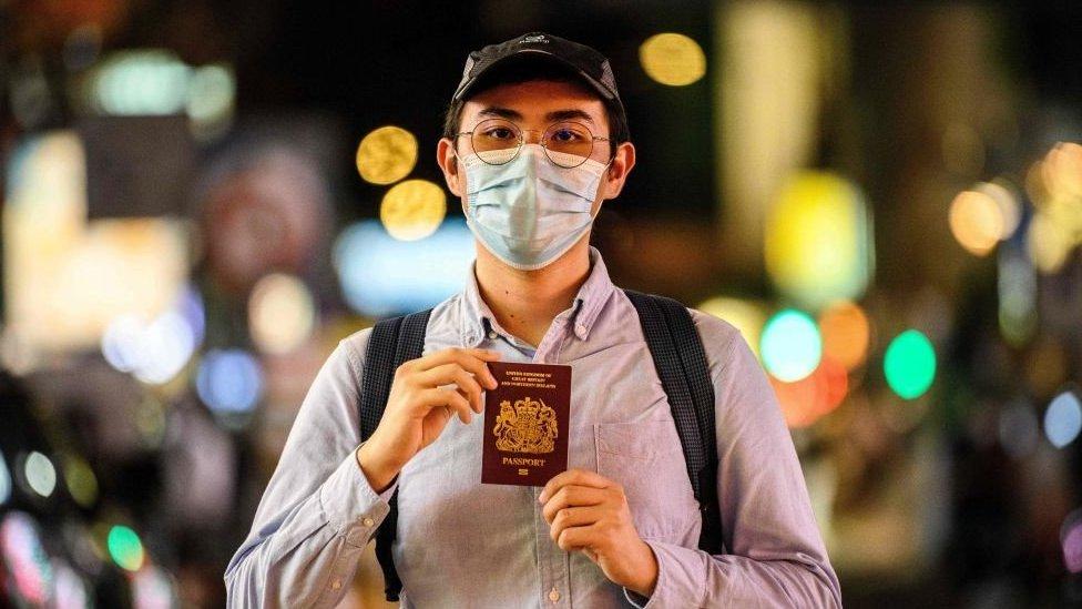 A young Hong Kong man shows his British passport