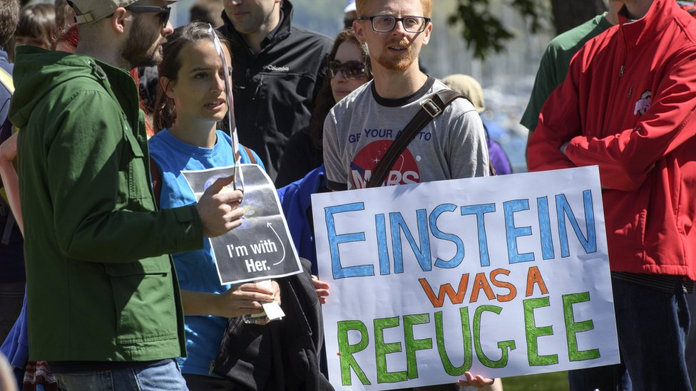 People holding placards during the March for Science day at the Jardin Anglais in Geneva, Switzerland, 22 April 2017