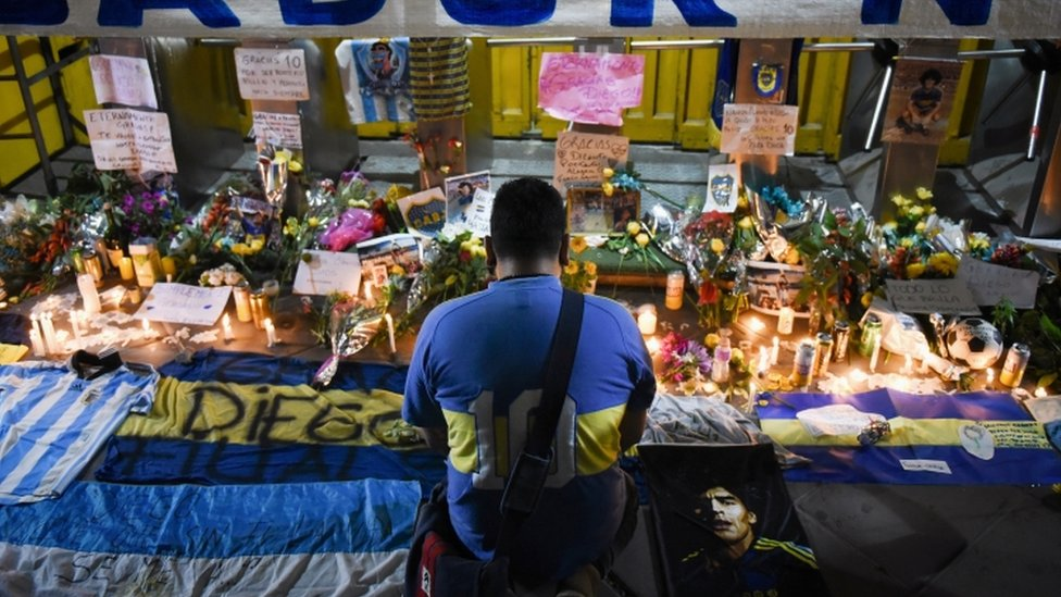 A man pays tribute at a vigil to Maradona