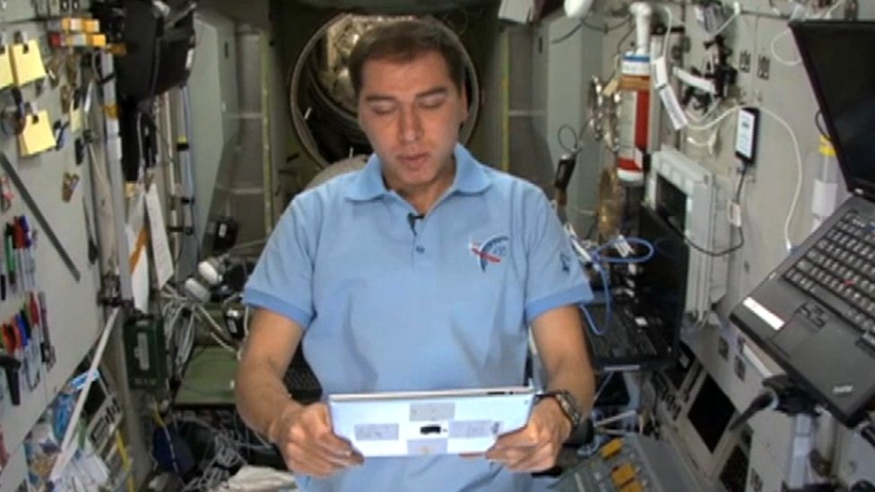 Cosmonaut reading Tolstoy in space