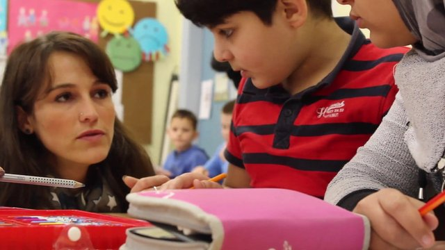 Amer, a 10-year-old Syrian, is learning German in Oberhausen's integration school