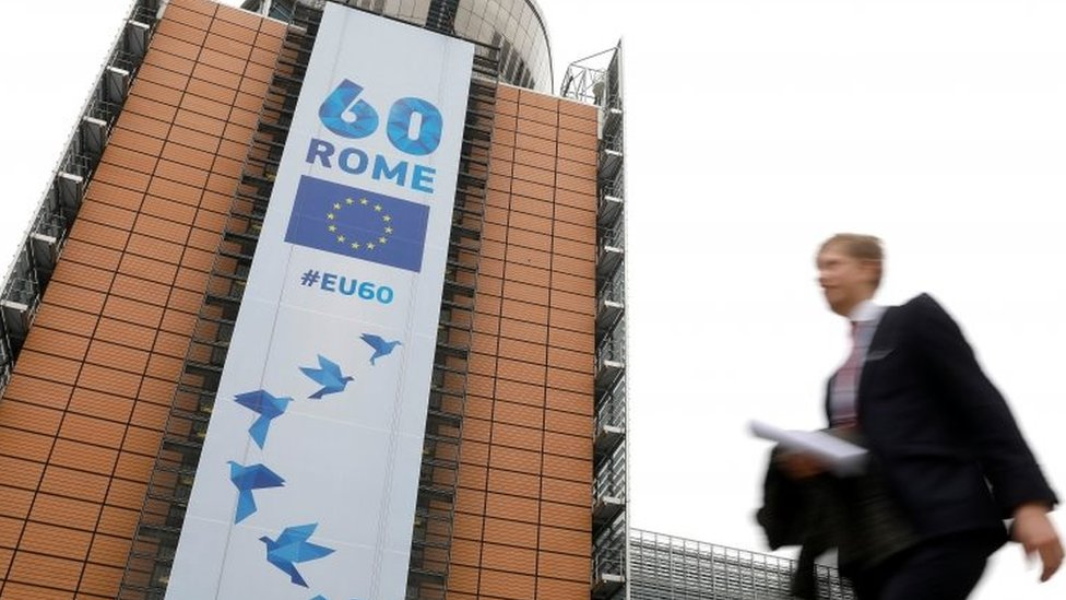 A banner marking the 60 years of the singing of the Treaty of Rome is displayed at the European Commission headquarters in Brussels. Photo: 20 March 2017