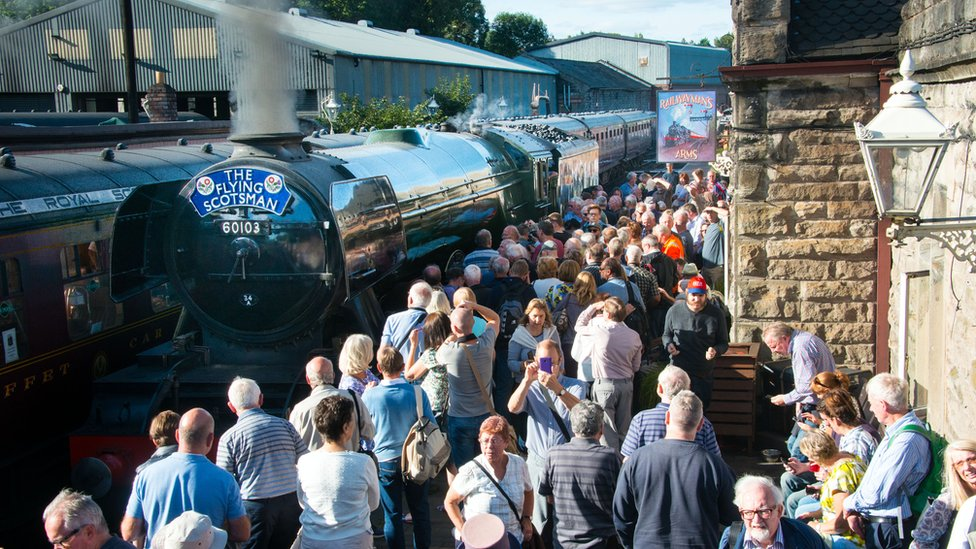 Crowds greeting the engine