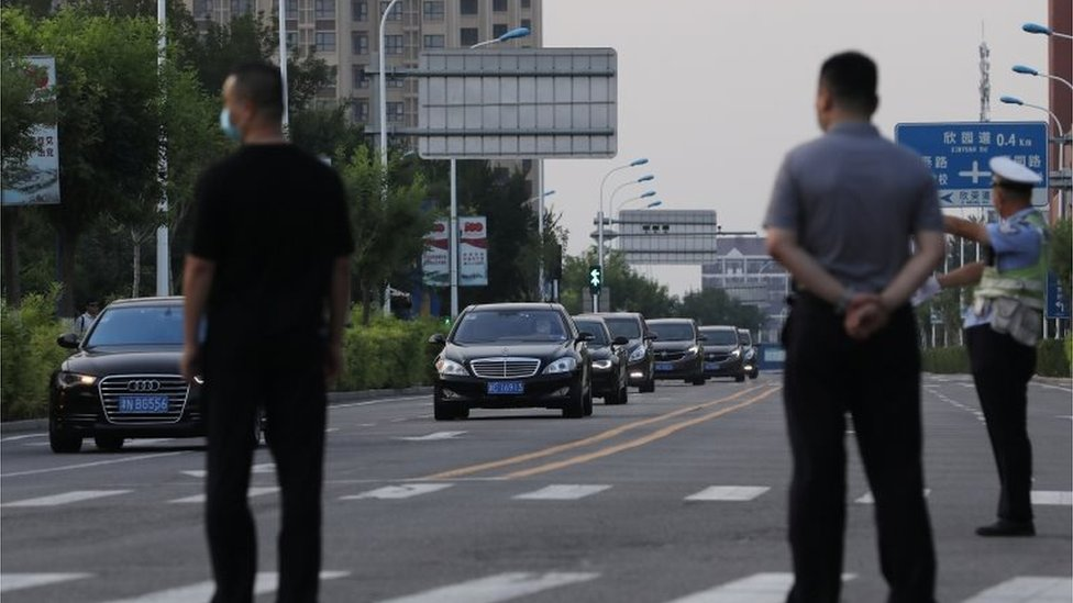 A convoy of vehicles arrives to a hotel where U.S. Deputy Secretary of State Wendy Sherman is expected to meet Chinese officials, in Tianjin, China July 25, 2021. Picture taken July 25, 2021.