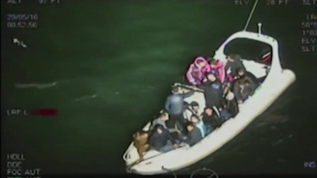 Smugglers and migrants on inflatable boat