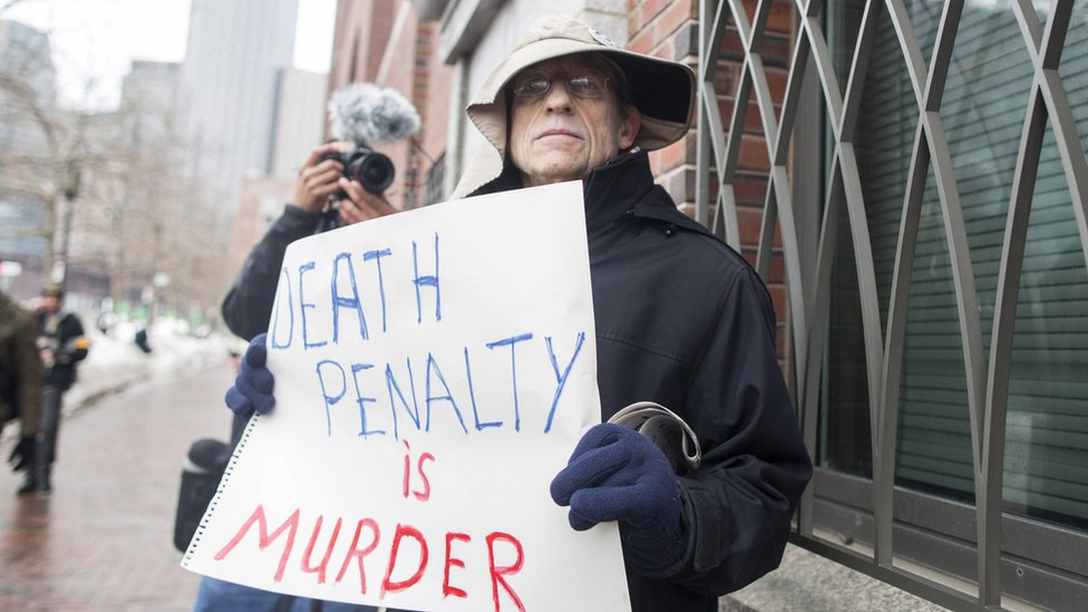 A demonstrator at the trial of Boston bomber Dzhokhar Tsarnaev, who was sentenced to death