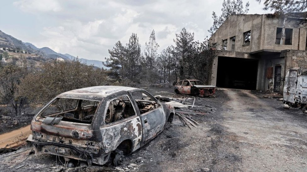 A destroyed house and car at a village on the southern slopes of the Troodos mountains