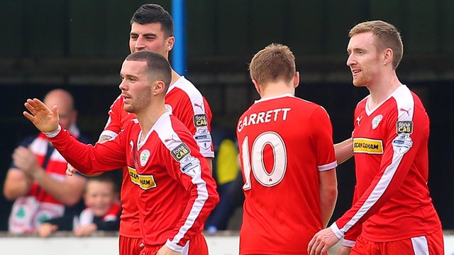 Cliftonville players celebrate victory over Dungannon Swifts