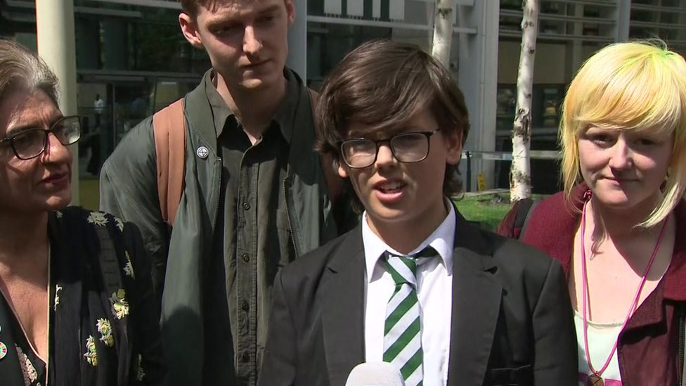 Extinction Rebellion members speak after the meeting with Michael Gove