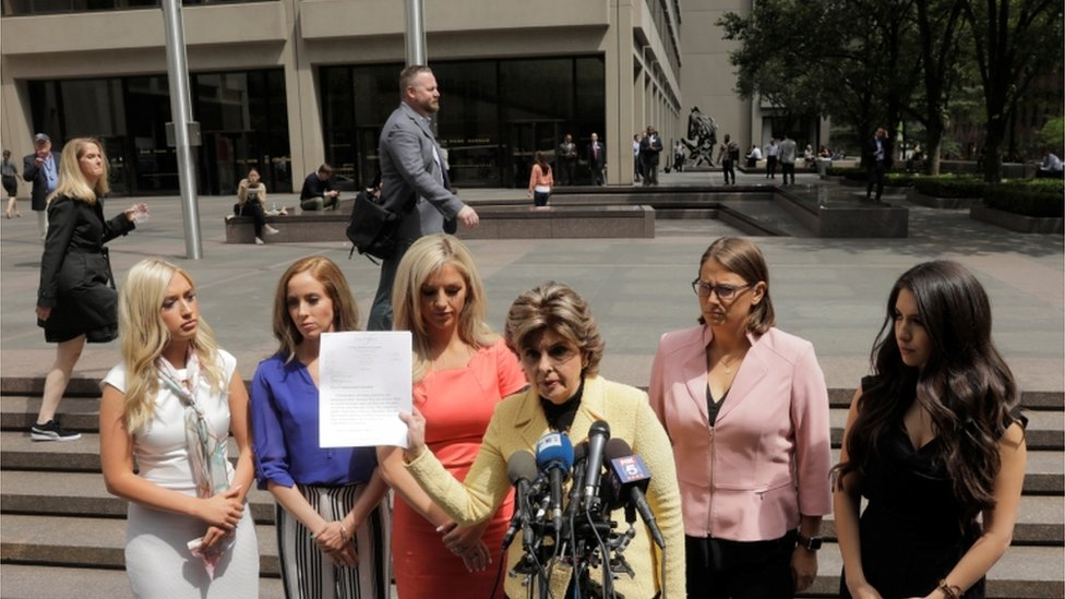 Former cheerleaders and lawyer outside of NFL headquarters in NYC