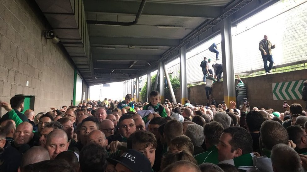 Celtic fans trying to escape the crush
