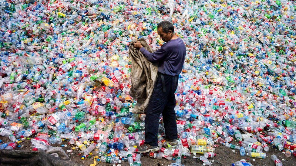 A Chinese labourer sorting out plastic bottles for recycling in Dong Xiao Kou village, on the outskirt of Beijing.