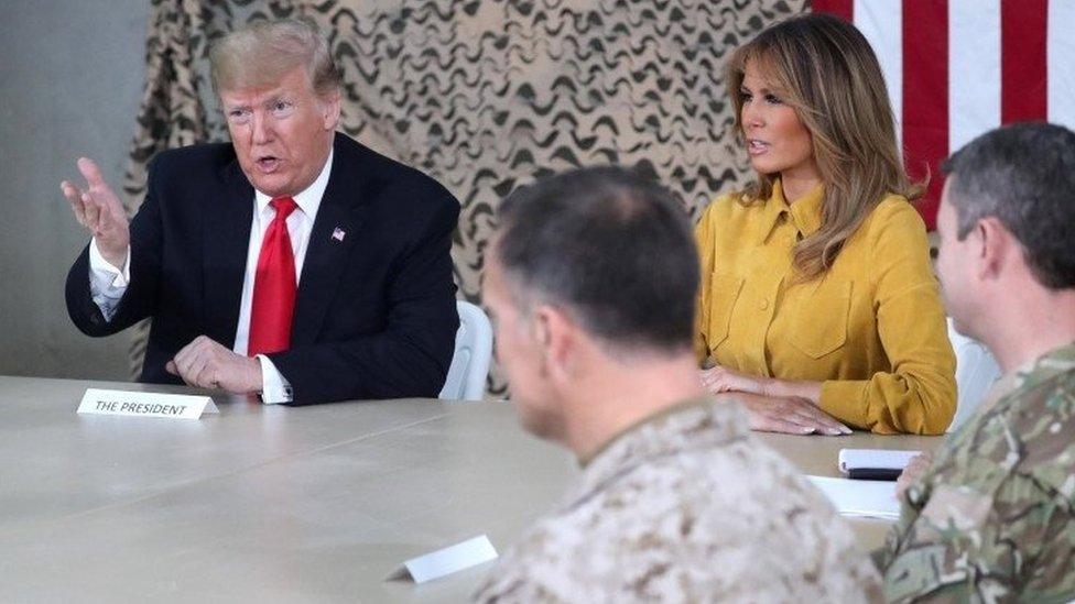 ترامب وميلانيا في قاعدة عين الأسد