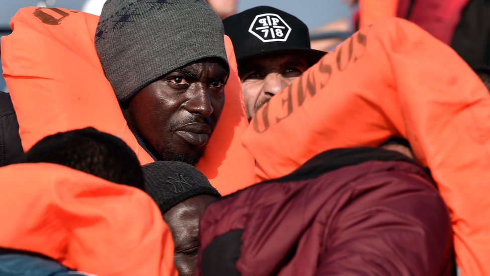 Italy migrants: Who is responsible for helping out at sea?