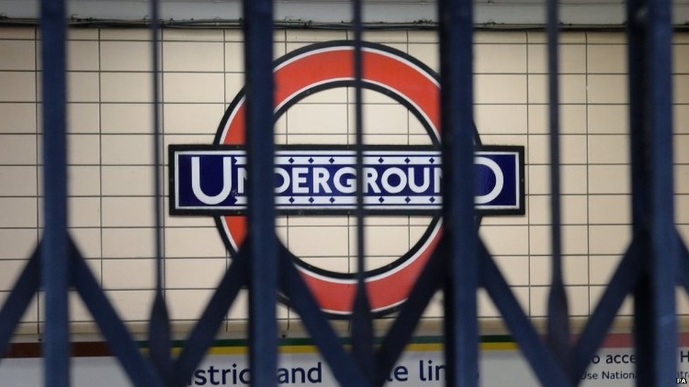 File photo dated 5/8/2015 of a London Underground sign seen through the gates to an entrance at Paddington Underground station