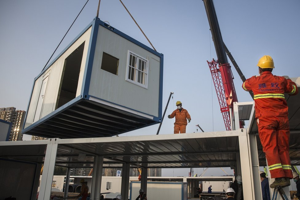A prefabricated building is lowered at Huoshenshan Hospital