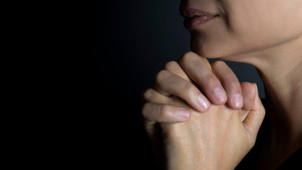 A praying woman