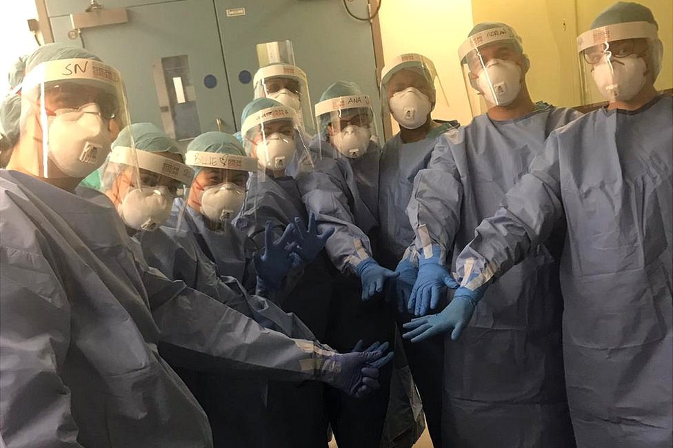 Nurses in protective equipment before the start of the shift