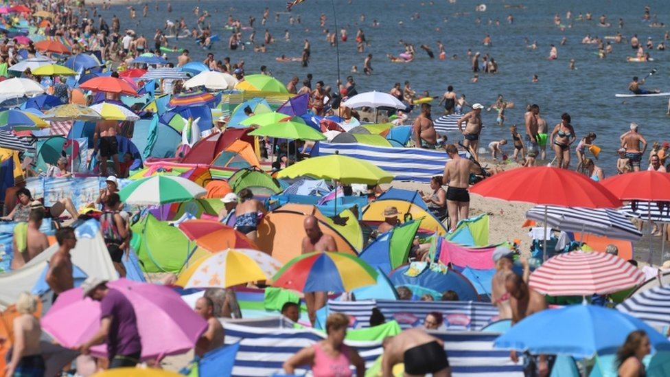 People crowd the beach at Zinnowitz on the island of Usedom in the Baltic Sea, northern Germany