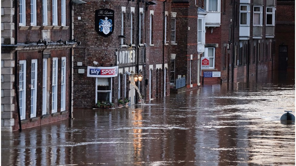 Flooding of riverside businesses near the River Ouse in York