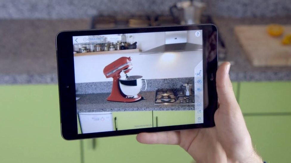 Tablet video camera showing food mixer superimposed on kitchen worktop