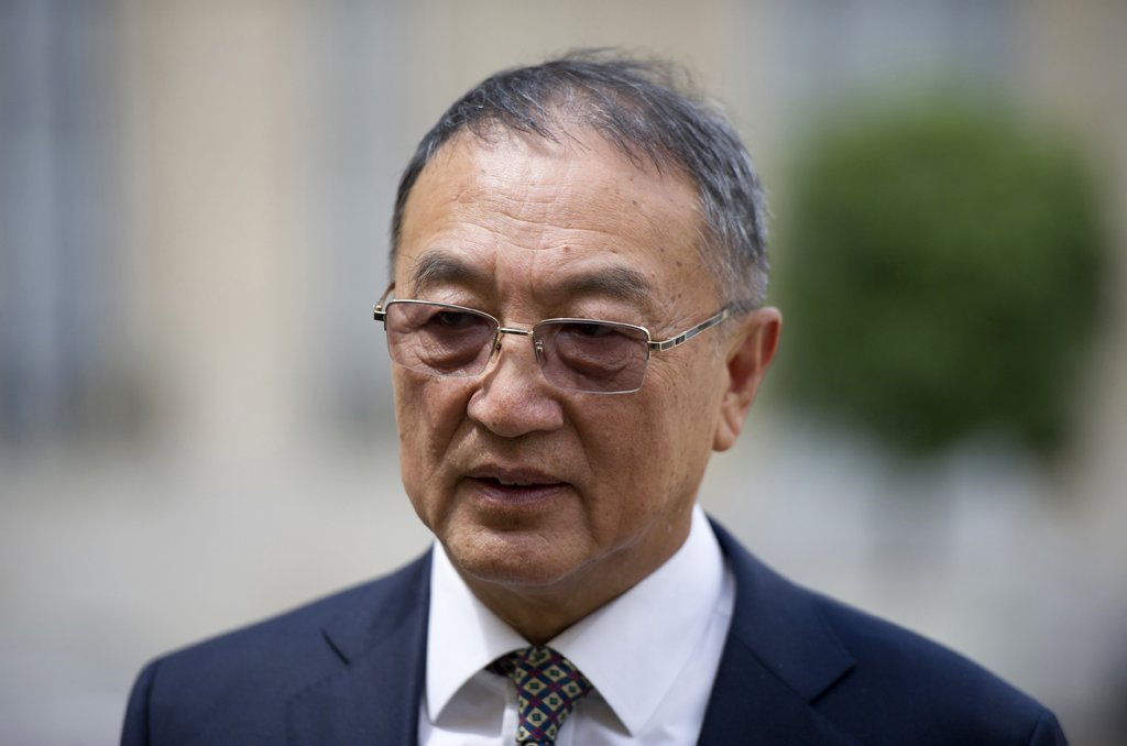 Chinese computer giant Lenovo chairman Liu Chuanzhi leaves the Elysee presidential Palace on June 25, 2013 in Paris after a meeting with French president. AFP PHOTO / FRED DUFOUR (Photo credit should read FRED DUFOUR/AFP/Getty Images)
